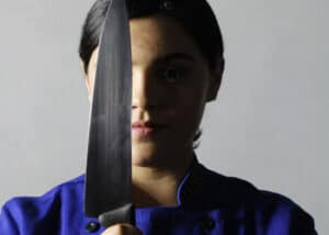 Best Chef Knife - Women holding knife vertically