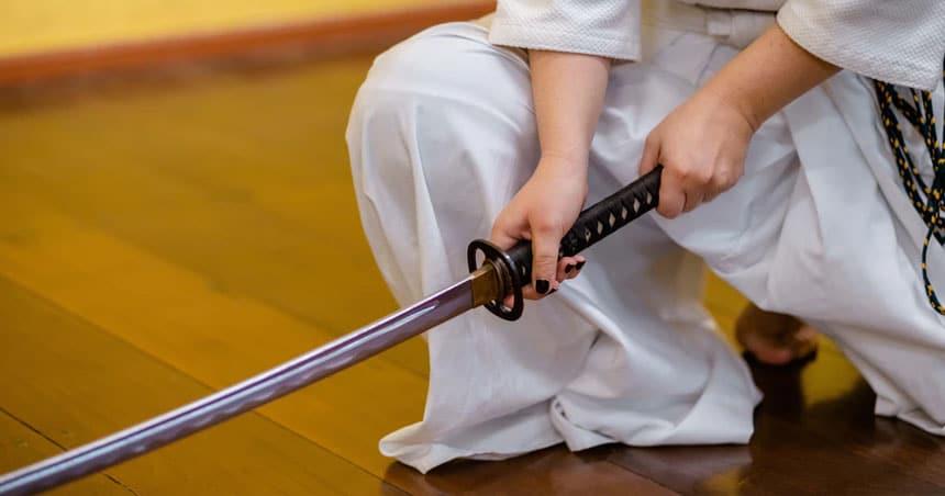 Women holding Katana Sword