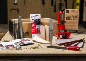 Knife making kit on work bench. Man Crate brand.